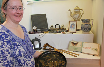 Jan Gough from Chesterfield Museum with items from the Orwin Collection