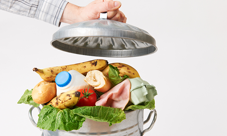 An image of food in a dustbin, representing food waste.