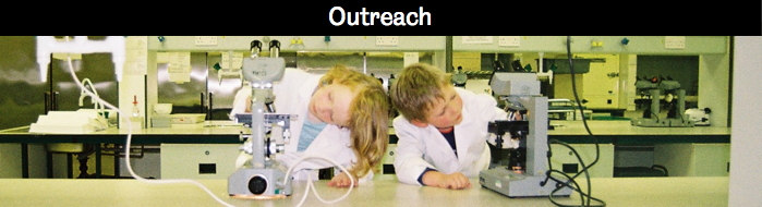 Children in lab at microscopes