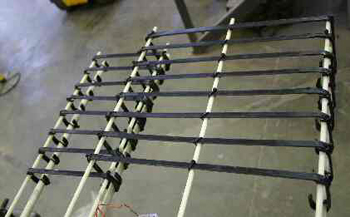 Curved FRP strips used as shear reinforcement