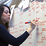 Researcher using a whiteboard
