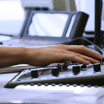 Image: close-up of hand and sound desk
