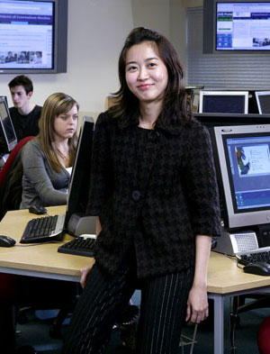 Image: student standing in broadcast newsroom