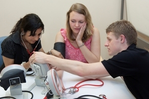 Three SOAMS students using emedical equipment