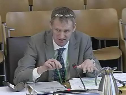Professor Alan Brennan at the Scottish Parliament