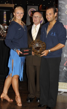 Sav and Charlie receiving dance award