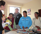 Some local Bolivian women and students Aimee Clark and Jon Gregg