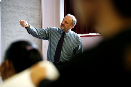 Photo: Lecturer pointing at blackboard
