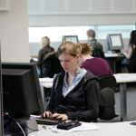 A student studying in the Information Commons