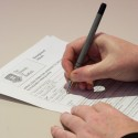 Photo of someone completing a form