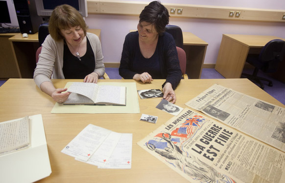 Jacky Hodgson and Dr Wendy Michallat with Madeleine's papers