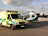 Photo of a an ambulance and emergency helicopter