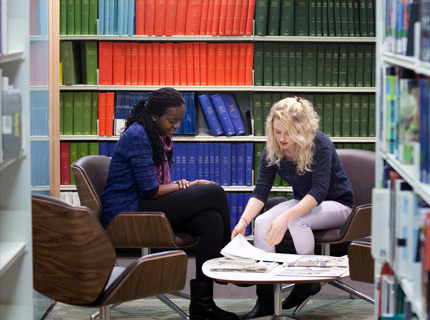 Postgraduate  research students studying in library