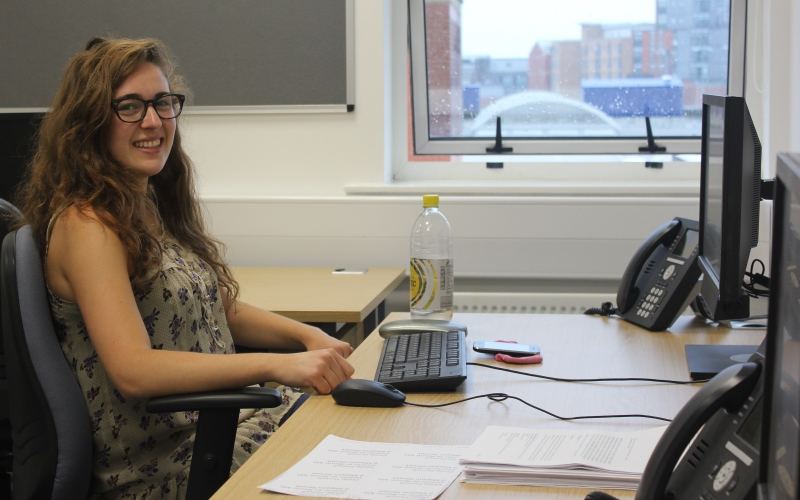 Photo of student Olivia Wills working at a desk