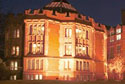 Photo: Firth court at night - link to information about the University