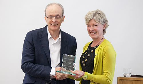 Picture of Professor Alan Walker receiving an award from Faculty Pro-Vice Chancellor Gill Valentine