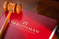 Ombudsman book and hammer