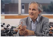 Professor Sir Harry kroto holding his Buckyball