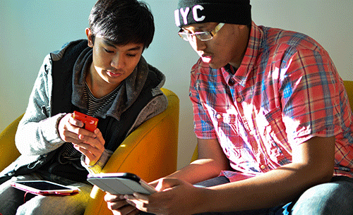 two students looking at a tablet
