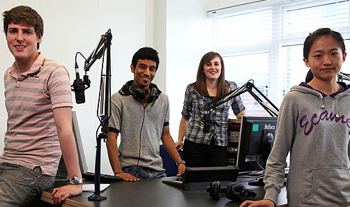 MA journalism students in a broadcast newsroom