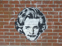 Photo of Thatcher's Face painted on a brick wall