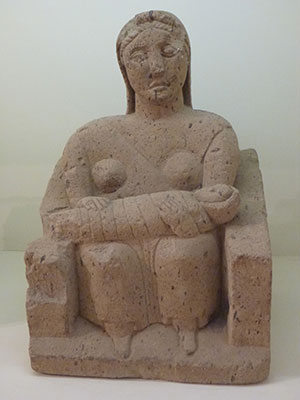 A votive statue of a woman and infant from Capua, Italy