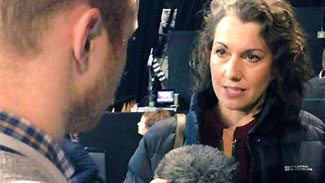 A student interviewing Sarah Champion MP on election night