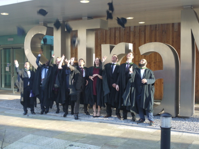 Graduating students outside SITraN