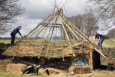 Students building a roundhouse in the Peak District