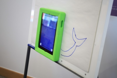 Photograph of a tablet on a flipchart
