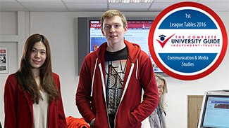 Students in the newsroom plus Complete University Guide number 1 badge