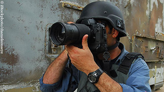 A photojournalist in a war zone