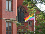 A rainbow flag flying outside of the University of Sheffield's Firth Court building