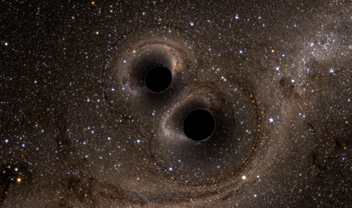 Two black holes merge into one creating a single, more massive spinning black hole