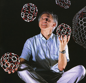 Harry Kroto juggling Buckyballs