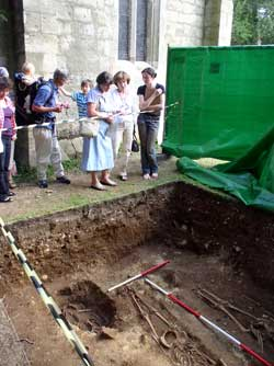 Visitors to the cemetery excavation at Brodsworth