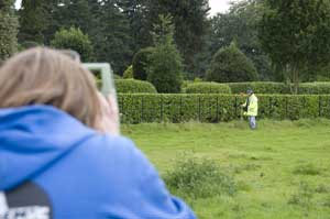Surveying the visible earthwork features of a Victorian flight pond at Brodsworth Hall (photo by Sarah Cole)