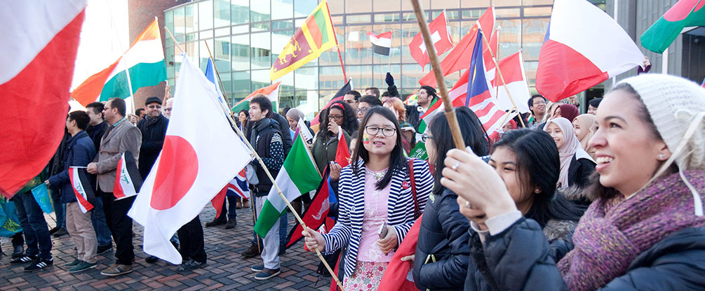 Students holding flags