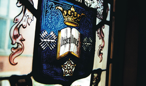 Picture of the university logo in stained glass