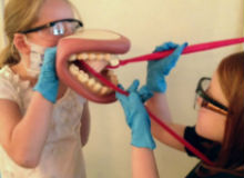 two children using mouth toy