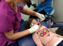 dentist working on child