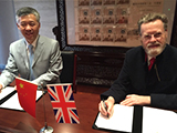 Professor Sir Keith Burnett and Professor Zhang Yibin sign the agreement.