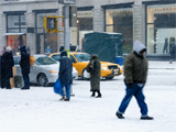 People walking in the street in New York City during a snow storm