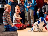 Children playing with robots