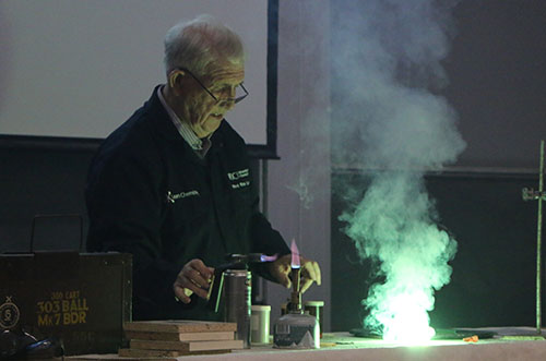 Rev. Ron Lancaster generating a green coloured firework