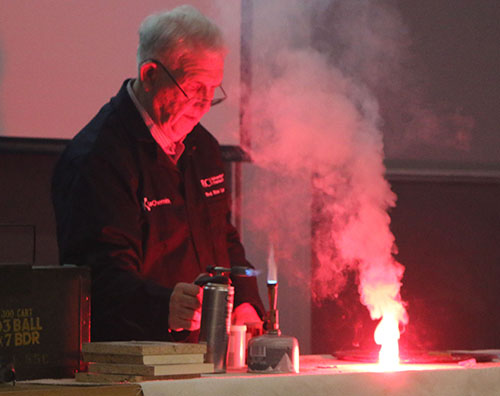 Rev. Ron Lancaster generating a red coloured firework