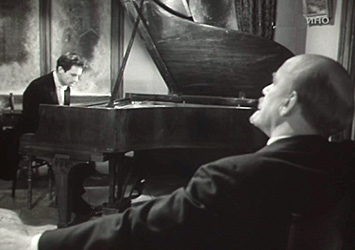 Man at piano with Lenin listening