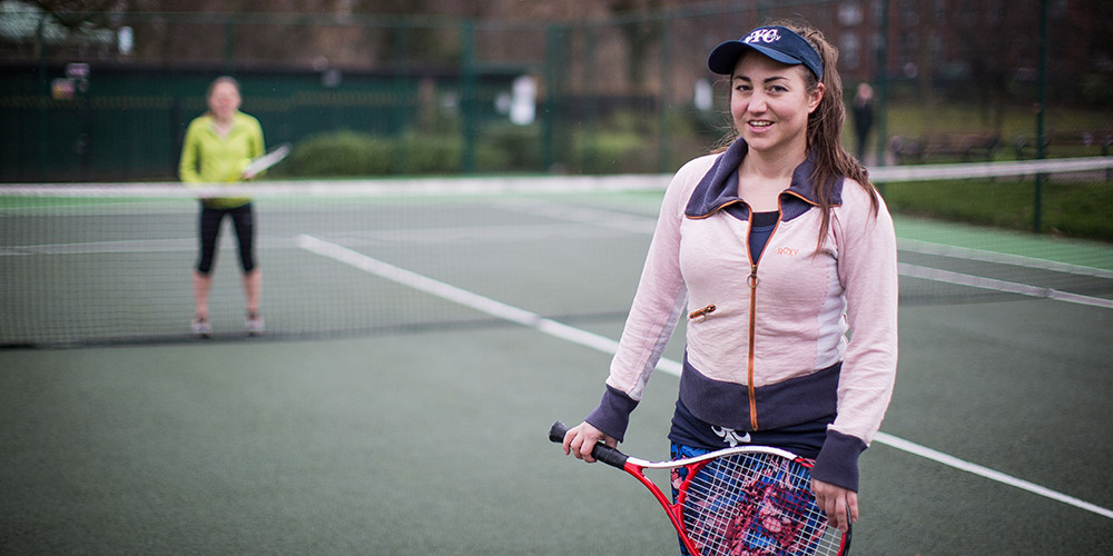 Laura on tennis courts