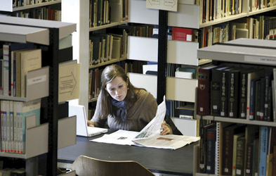 Photo of female student in library