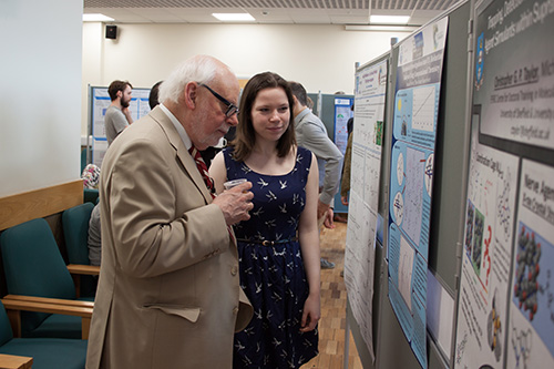 Hannah and Sir Fraser at the poster session